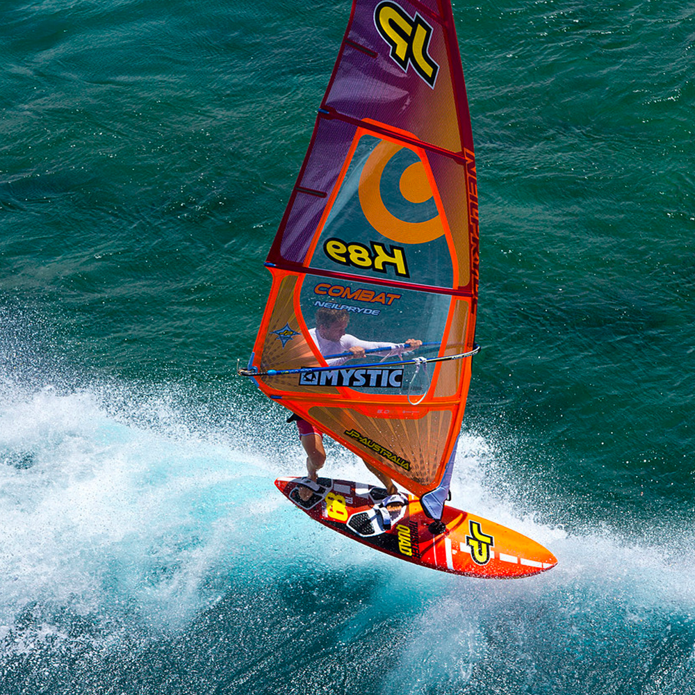 Jp-Australia-Thruster-Quad-Pro-2017-windsurf-board-action.png